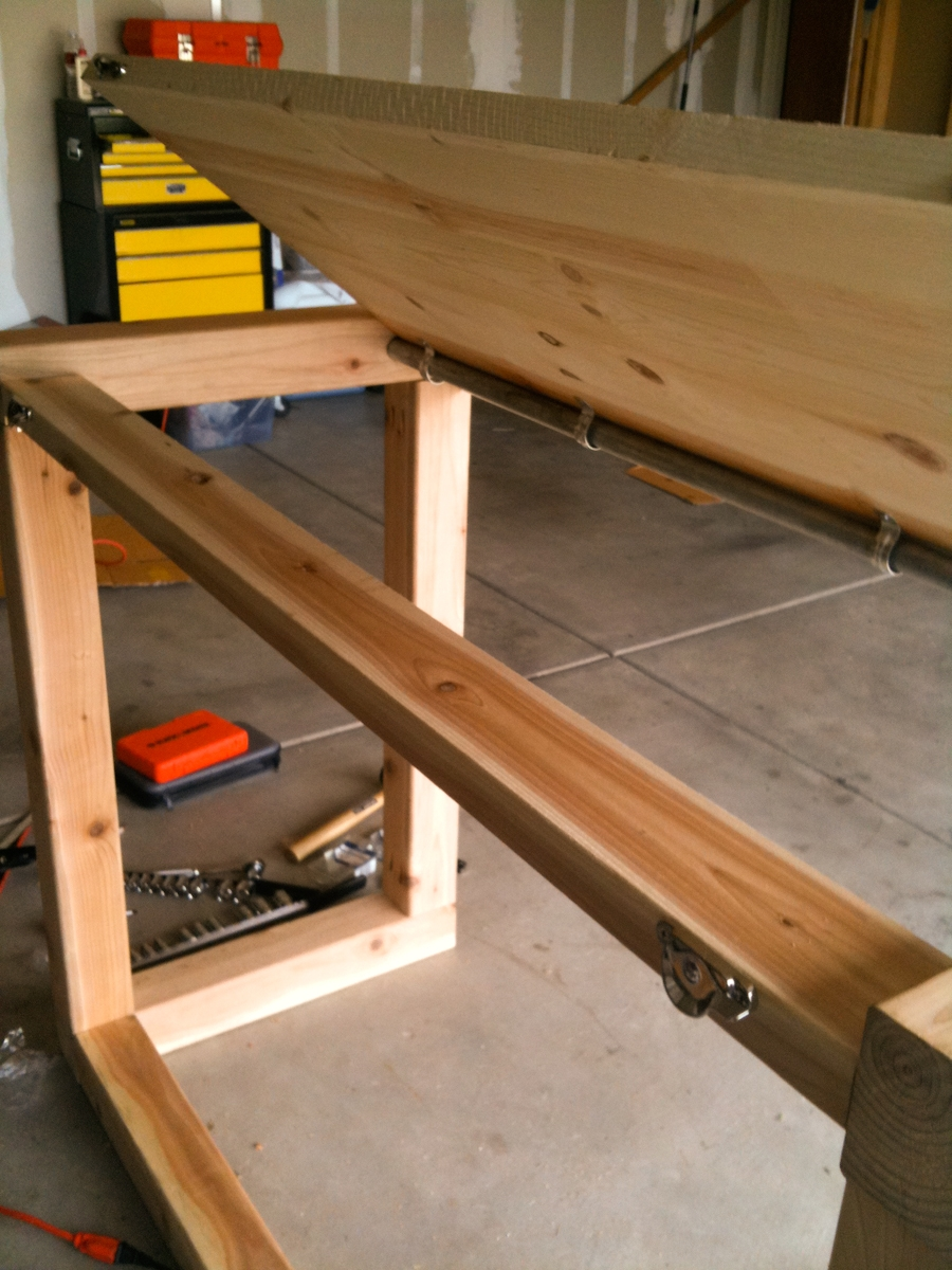 Stability 2x4 that the top rests on of a standing drafting table